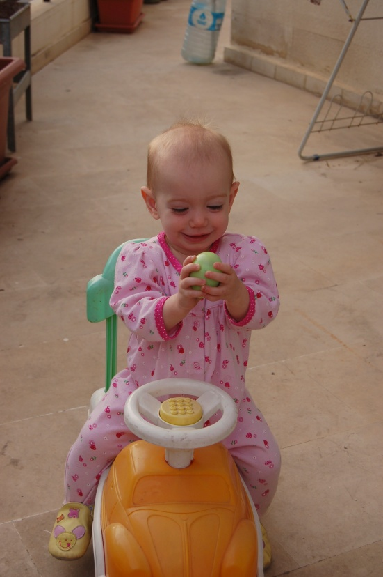 Ruby was just happy to ride her car around... though the egg did look fun!