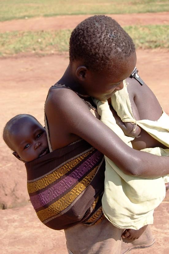Babies wearing babies. Uganda 2007